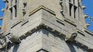 Detail of the tower showing the gargoyles and the drummer at the corner of the frieze